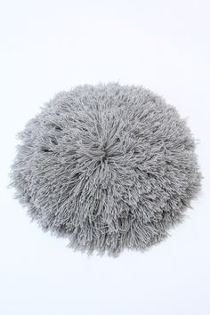A new larger version of our standard fringe pillow. Each one is unique. Knit and sewn by hand. soft alpaca yarn with cotton back and padding. Aprox across. Use as a pillow, cushion or hang on Cheap Pillows, Grass Decor, Boutique Design, Floor Pillows, Decorative Throw Pillows, Hand Sewing, Knitted Hats, Winter Hats, Objects