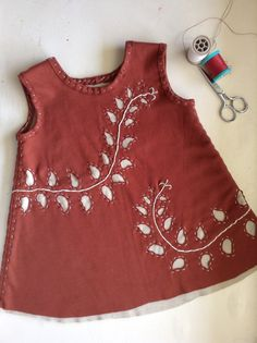Burnt orange and cream vine motif. 6-12 month baby dress or 2-3 T tunic. Hand stenciled and sewn. Made from 100% up-cycled cotton jersey. via Etsy