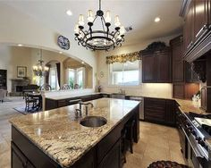 Dark kitchen cabinets, brown granite