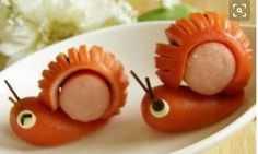 Great recipe for Wiener Sausage Snails For Lunchboxes I thought of these snails for a bento during the rainy season When making the cuts in the sausage in Step use a toothpick on the side of the sausage close to you to act as a stopper and preve - f Cute Food, Good Food, Funny Food, Food Art For Kids, Cute Bento, Kawaii Bento, Food Decoration, Food Humor, Bento Box
