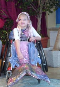 my darling daughter in hand made costume. This its a child in a wheelchair, So..its the little Mermaid :)
