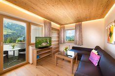 Neue Berghof-Suiten - Wohnzimmer - Verwöhnhotel Berghof 4-Sterne-Superior Salzburger Land Österreich © www.hotel-berghof.com