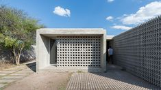 Concrete homes offer modern design on a budget in Argentina - Curbedclockmenumore-arrownoyes : The architect used a variety of textured concrete blocks and glass to form a series of considered spaces Minimalist House Design, Minimalist Architecture, Modern House Design, Modern Architecture, Concrete Houses, Concrete Blocks, Cinder Block House, Cinder Blocks, Low Cost Housing