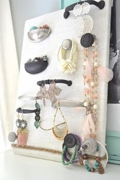 Hardware display board and collection of drawer pulls to hang everything. The cupped pulls were used as mini bins.
