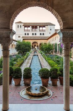 Courtyard garden in the Alhambra, a palace and fortress complex located in Granada, Andalusia, Spain