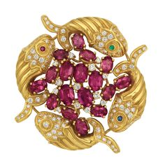 Gold, Rubellite and Diamond Clip-Brooch, Aldo Cipullo   18 kt., centering a cluster of 17 oval rubellites, accented by round diamonds, surrounded by four fluted gold fish, their heads and tails set with small round diamonds, with small round cabochon ruby, sapphire, emerald and diamond eyes, totaling 98 round diamonds approximately 2.15 cts., signed A. Cipullo, approximately 21.3 dwts.