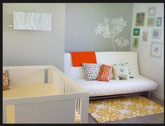 Futon sofa bed in nursery so it can still double as a spare room for guests