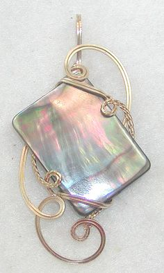 Look at the amazing play of colors!  Natural black mother-of-pearl shell in a 14kt gf wire-sculpted pendant.  $44.00.  Contemporary Concepts : Handmade Jewelry : One of a Kind Items.  http://www.wiregems.com