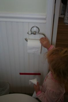 A Potty Training Tip! Put tape on the wall to show toddler how much paper to use....