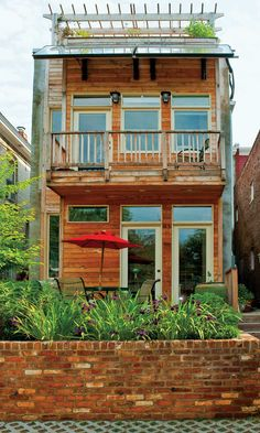 Along with the roof garden, this early 1900s renovated row house offers a second-floor balcony and a small backyard patio and raised planter.