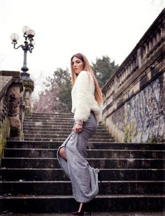 Negin Mirasalehi pairs a fluffy white jumper with a grey maxi skirt and accessorises with red skyscraper heels | Fashiolista.com