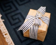 Love the blue and white stripe with the brown paper wrap.