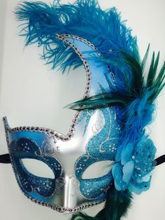 Teal and Silver Mardi Gras Masquarade mask with ribbon ties. Each of these handmade masks are a little different. Mardi Gras Carnival, Carnival Masks, Carnival Costumes, Diy Masquerade Decorations, Mardi Gras Decorations, Mask Face Paint, Mask Painting, Masquerade Ball Dresses, Masquerade Party