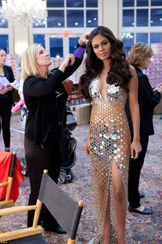 The Miss Universe contestants are touring, filming, rehearsing and preparing to compete for the Miss Universe 2014 crown to be decided on 25 January 2015 in Miami. Here,Miss Universe India 2014, Noyonita Lodh, has her hair done by a stylist backstage