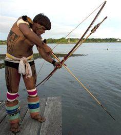 Indio e sua cultura de pesca - a pesca com arco e flexa - brasil