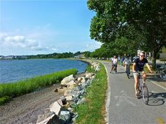 From Providence to Bristol, the beautiful East Bay Bike Path features a coastal biking route with scenic views of the Narragansett Bay. Visit Bristol, Bristol City, Lake Beach, Beach Town, York Beach, New England Travel, Travel Activities, Fun Activities, Bike Trails
