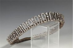 An Edwardian diamond tiara, the gift of the 6th Earl Spencer to his daughter, composed of alterna