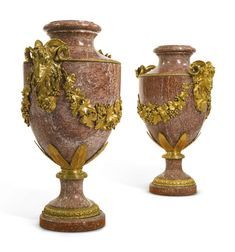 A large pair of Louis XVI style gilt bronze mounted Rose Vif des Pyrenees marble urns