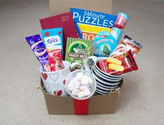 A great gift for a couple, buy this for your favourite two 2 people, Christmas gift box, filled with games and lovely bits - pack it in gift box, filled boxed hampers, an unusual xmas present idea. www.packitingifts.co.uk