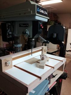 Drill press table with removable insert