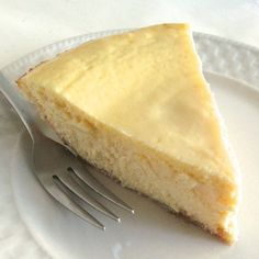 Ricotta Pie - A lighter textured cheesecake flavored with amaretto and a graham cracker and almond crust.