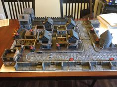 Our first town in a new Savage Worlds RPG with the help of DwarvenForge tiles. Rpg Board Games, Savage Worlds, The Help, Tiles, Table Settings, My Favorite Things, Room Tiles, Tile, Place Settings