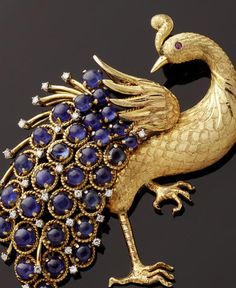 A sapphire and diamond set peacock brooch