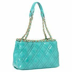 """Add a pop of style to evening ensembles or weekend apparel with this chic faux leather tote, showcasing a timeless quilted design and woven chain accents.  Product: ToteConstruction Material: Faux leather and polyesterColor: TurquoiseFeatures:  Middle divided pocket with zipperBack zippered pocketChained straps Dimensions: 7"""" H x 10.5"""" W x 4.5"""" D"""