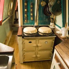 Multi-fuel stove with back boiler, used year round on narrow boat