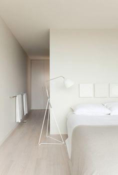 Neutral tones. Off-white walls + light wooden floors.