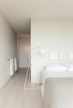Neutral tones. Off-white walls + light wooden floors.