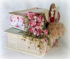 like the flowers on the side of the one, and the bit of lace embellishment on the bottom one...cool thing to do to books, no fairy