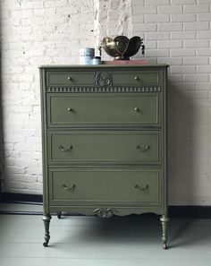 Rich and classic dresser painted with Chalk Paint®️️ in Olive and protected with Clear Chalk Paint®️️ Wax | Knobs accented with Annie Sloan Gilding Wax in the color Warm Gold | Project by Annie Sloan Stockist Vintage Style and Designs of Louisville & New Albany, IN