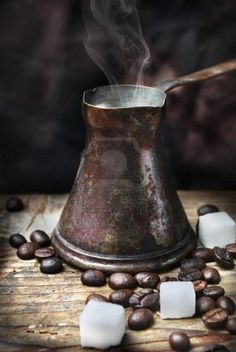 Old-fashioned oriental coffee pot on grunge wooden plank Love Coffee - Makes Me Happy