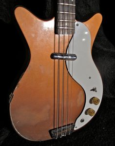 Oh man, check out this hot mess. 1960s Shorthorn Danelectro Bass Guitar