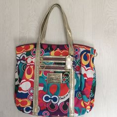 Coach Poppy tote Colorful cotton tote bag! Gold leather straps. Teal inside with zipper pocket and two slip pockets. Outside front has two zip pockets. Great bag! Price firm. Coach Bags Totes