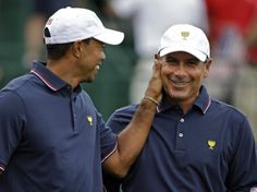 AWW!!! -- United States' Tiger Woods, left, pats captain Fred Couples on the face before the start of a four-ball match against the International team at the Presidents Cup golf tournament at Muirfield Village Golf Club Thursday, Oct. 3, 2013, in Dublin, Ohio. (AP Photo/Darron Cummings)