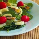 Yes!  Warm Spinach Salad Add feta, almonds and craisins after wilting spinach.  Yummy!