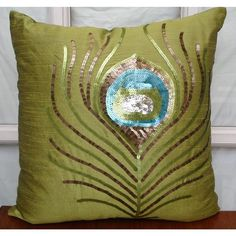 Green Peacock Feather - Throw Pillow Covers, via Etsy.