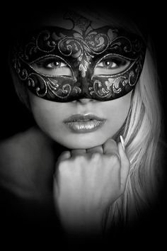 beautiful girl wearing a masquerade mask