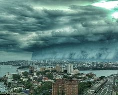 This spectacular shot was captured from North Sydney, as a massive storm cloud moved across the city on Friday