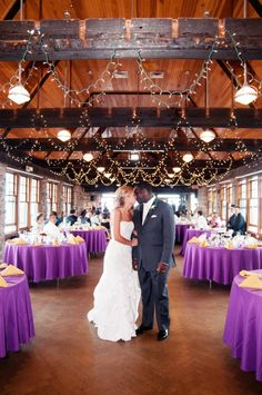 Rent Purple Tableclothspurple wedding decor   Love the exposed brick   Photo by  www  . Purple Tablecloths For Wedding. Home Design Ideas