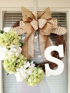 This gorgeous hydrangea wreath is perfect for Spring and Summer! The 18 grapevine wreath is complete with altering green and white artificial hydrangeas