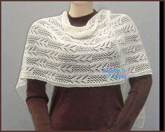 Estola con hermosos calados tejida en algodón pima con hilo lamé.