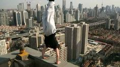 The British freerunner has travelled the world performing a series of extreme stunts on the edge of tall buildings. | Daredevil Travels The World To Perform Extreme Handstands On The Edge Of Buildings
