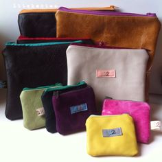 Varying sizes of our handmade leather pouches with spotty linings