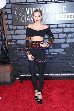 Miley stuck to a matching look with this vintage jeweled legging and crop top set. Brand: Dolce & Gabbana