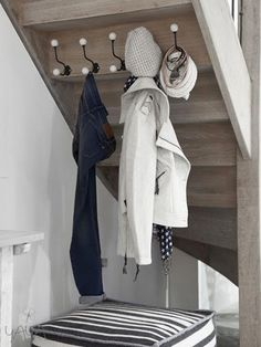 hooks under staircase for bath room closet
