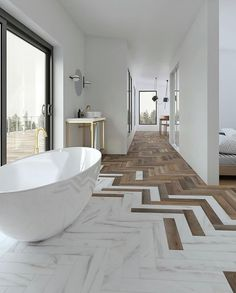 Modern, neutral bathroom with freestanding bath and herringbone floor, herringbone wood floor and ma Loft Interior, Interior Photo, Luxury Homes Interior, Interior Lighting, Modern Lighting, Modern Bathroom Design, Bathroom Interior Design, Marble Interior, Modern White Bathroom