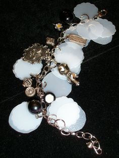 Black & white whimsical silver bracelet made from upcycled milk jugs and misc jewelry parts by Changedidentity